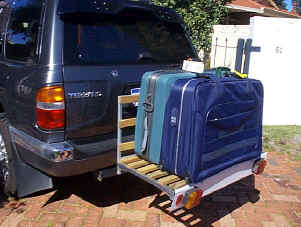 Luggage rack with suitcases